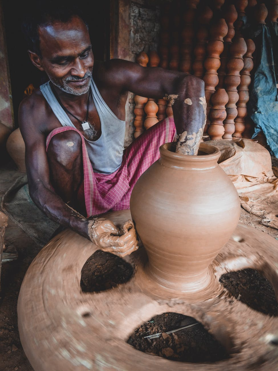 man making clay pot