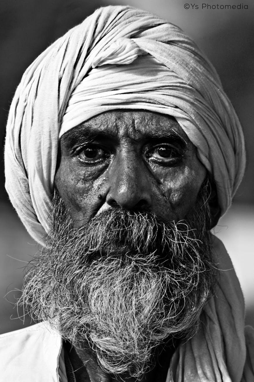 man wearing white turban grayscale photo
