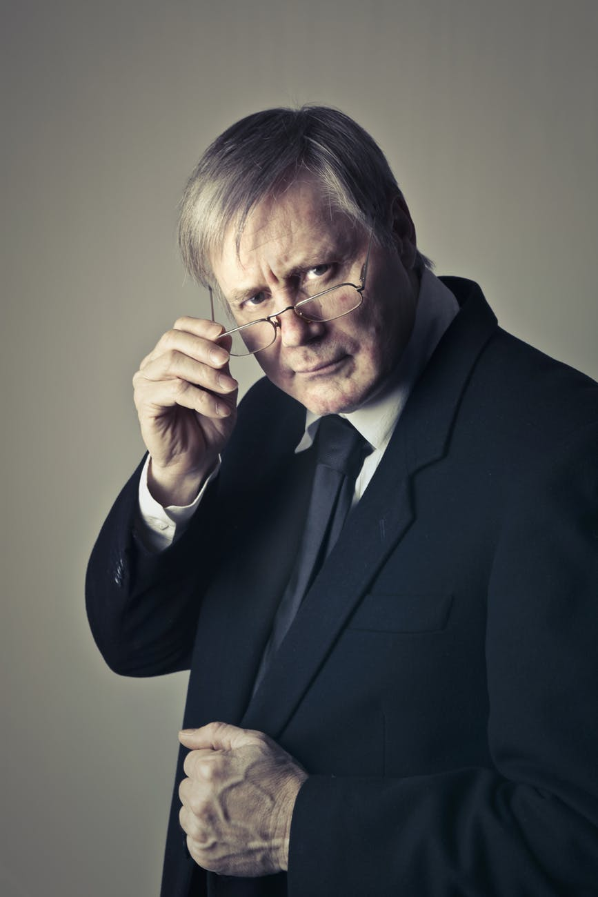 close up photo of man wearing black suit jacket