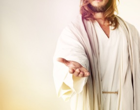 Cropped studio shot of Jesus Christ extending his arm in assistance