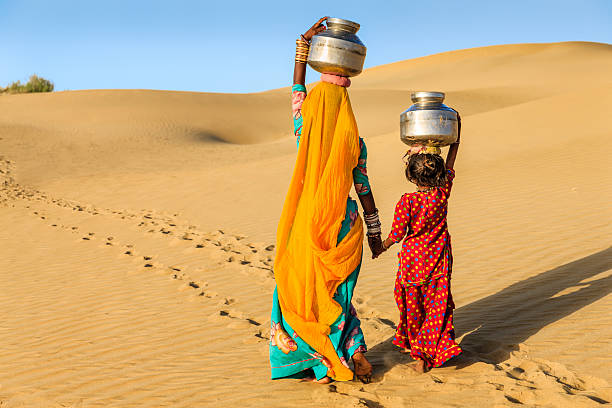 Woman carrying water in desert Photo from freeimages.com.jpg