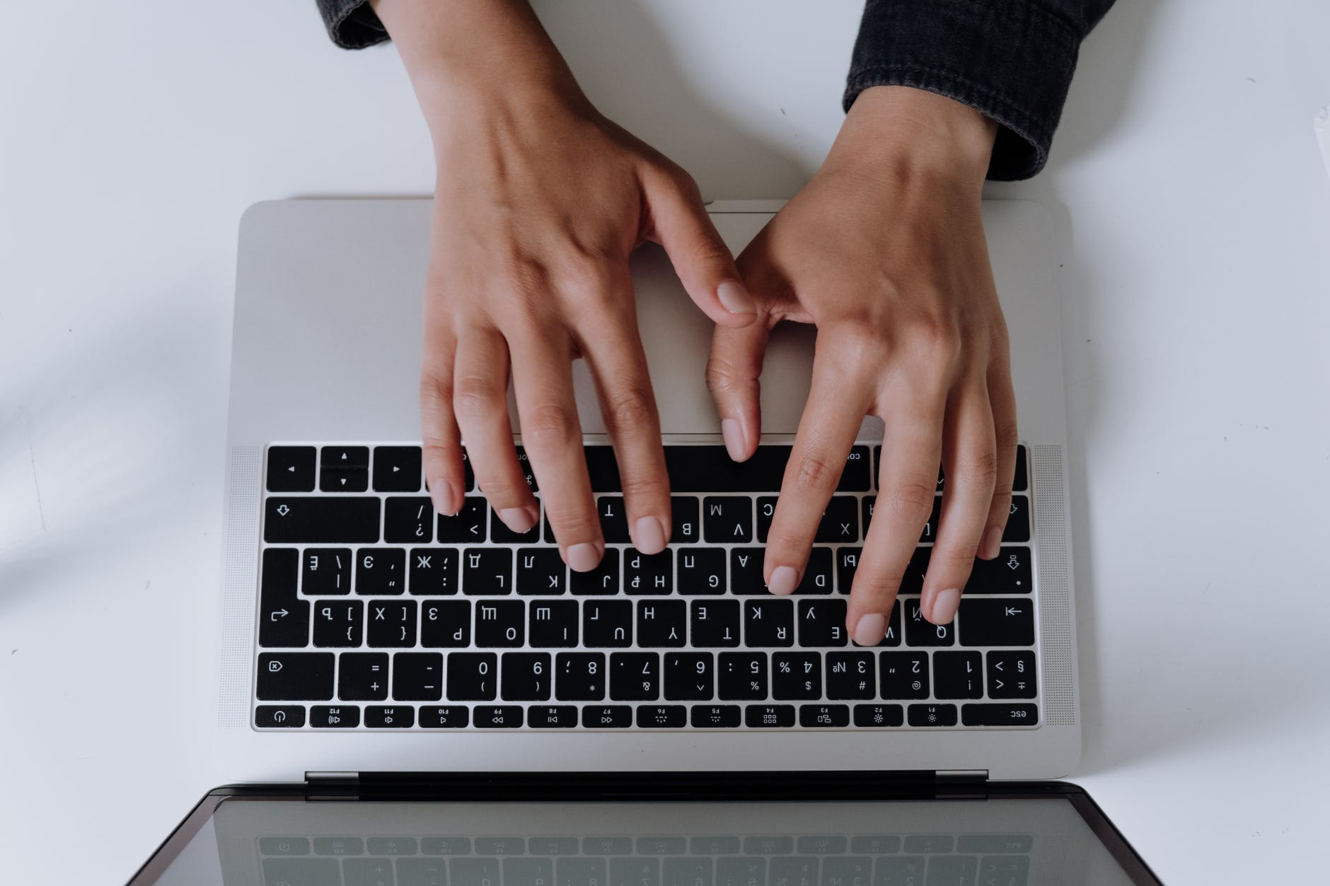persons hand on silver and black laptop computer