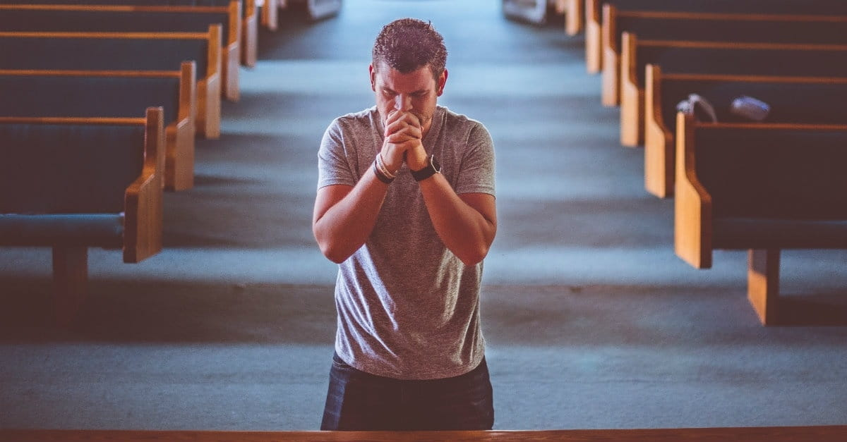 man praying unsplash photo from Crosswalk.com